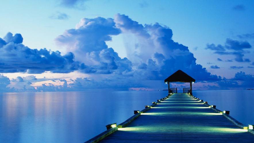 A dock at sunset on White Sands Island in the Maldives.