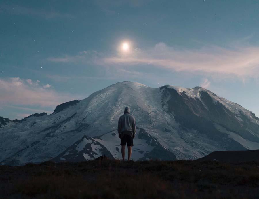 Man staring at mountain